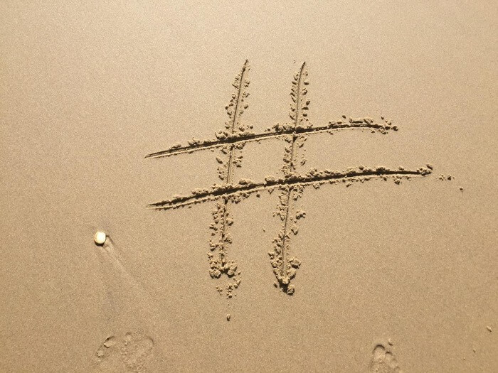An image showing a hashtag encouraging to use social media wall