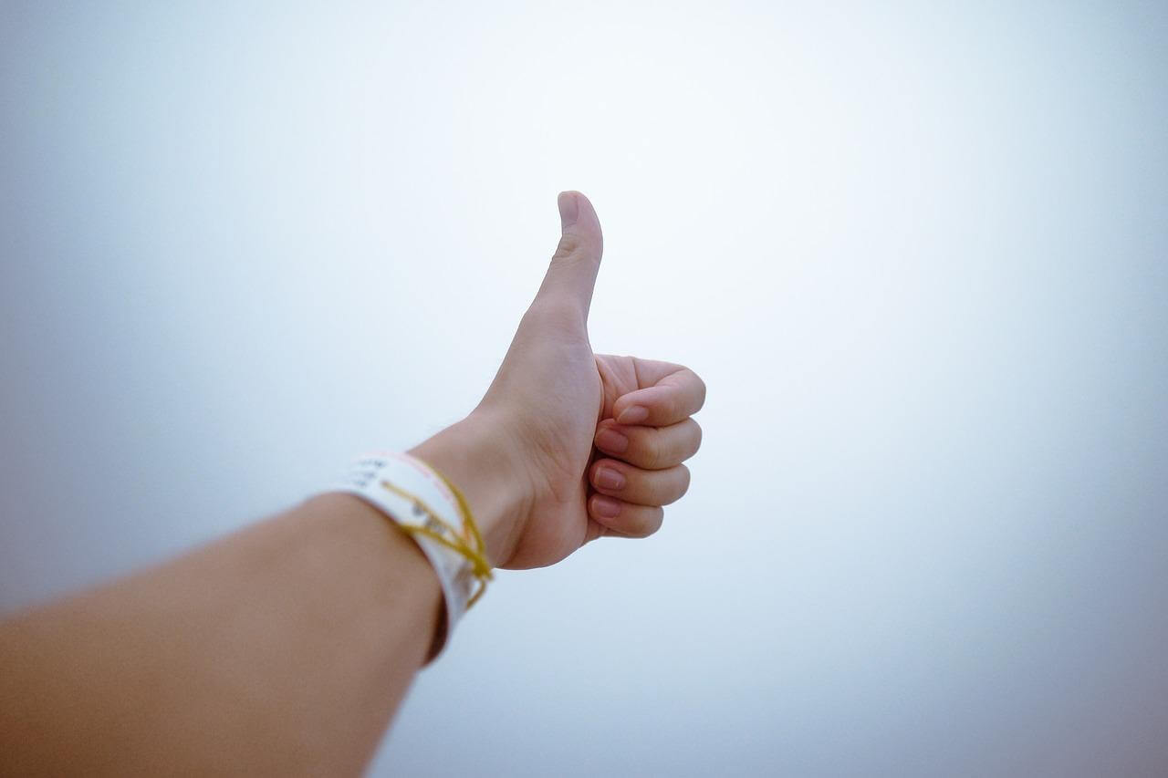 A thumb up as social proof one can show in a social media wall