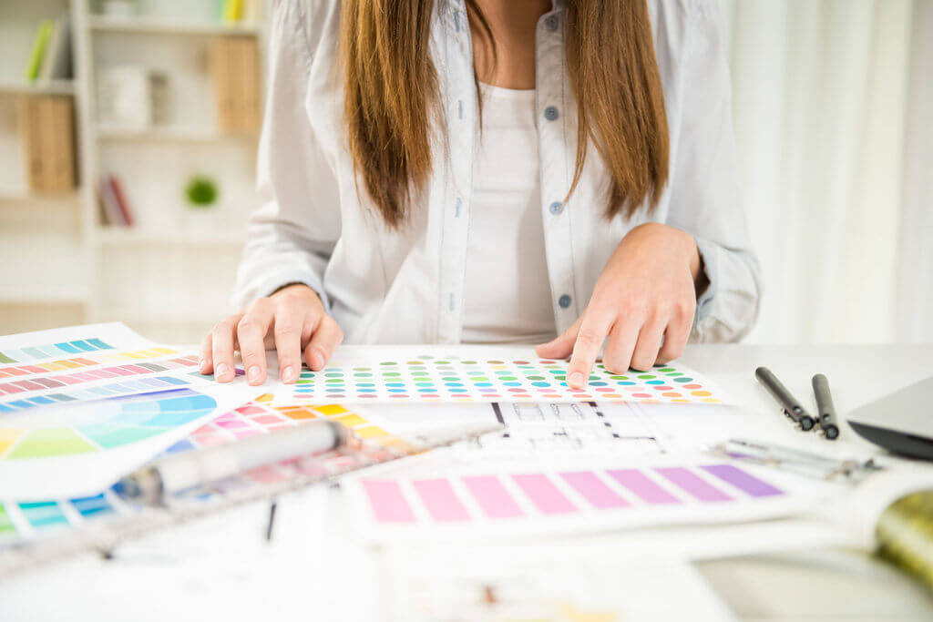 designer working with color samples in her office.