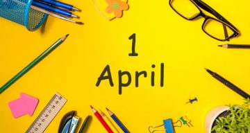 desktop with yellow background and ! April written in comic sans