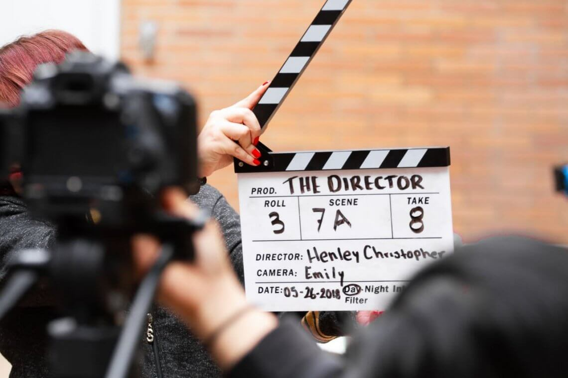 a camera on the foreground and clapperboard on the second