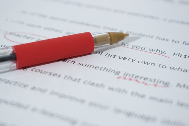 paper being graded with red pen
