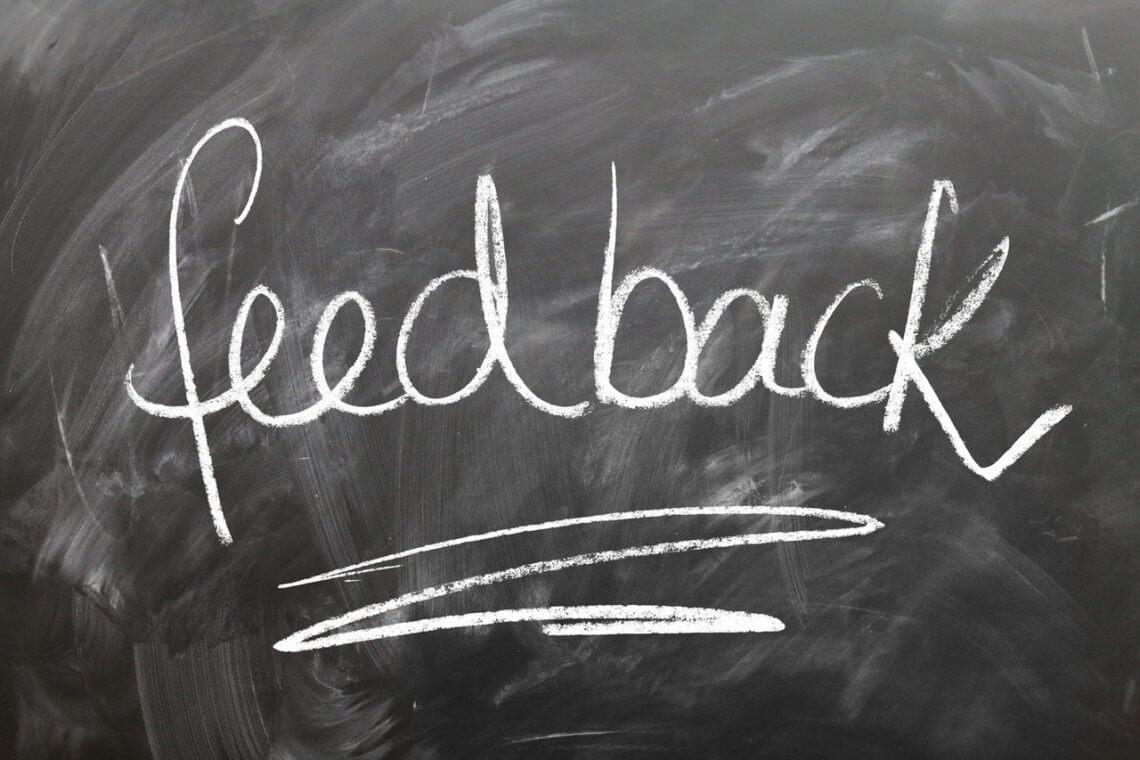 """word """"feedback"""" written on a chalkboard"""