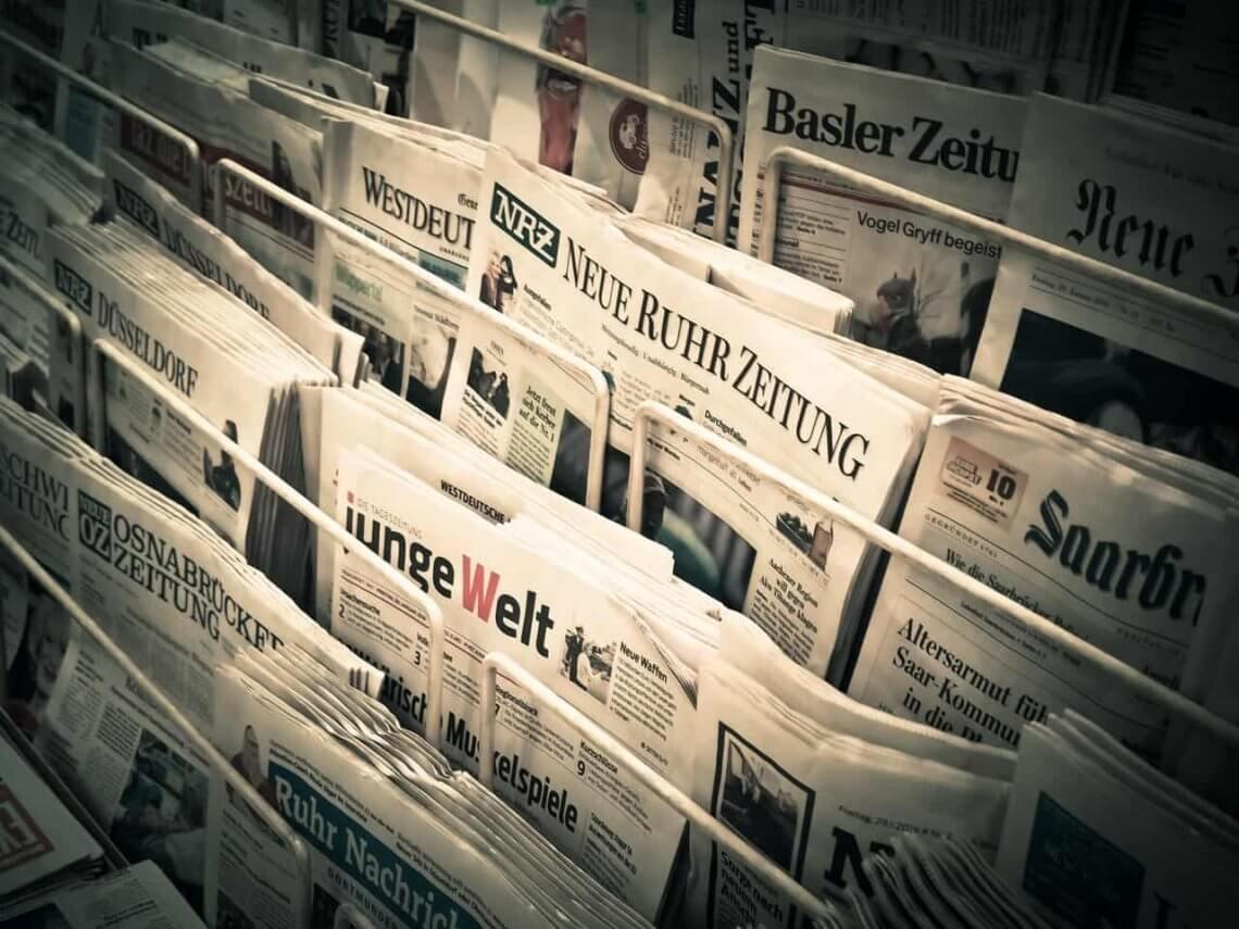 newspaper rack with newspapers