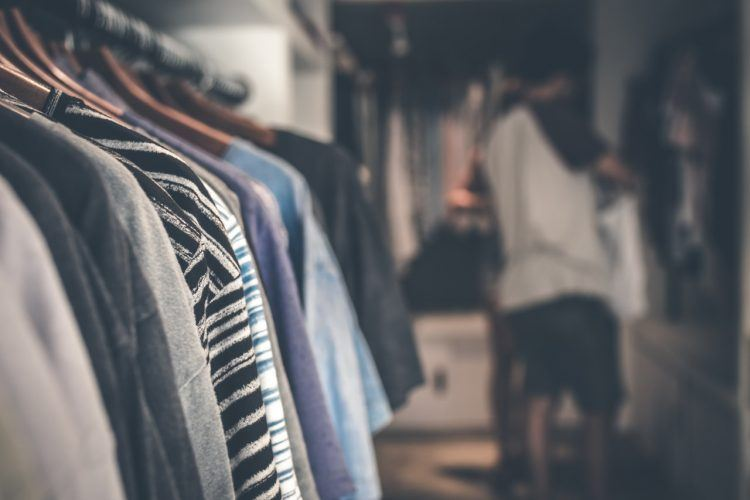 a rack with clothes in a store