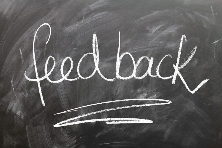 word feedback written with chalk on a blackboard