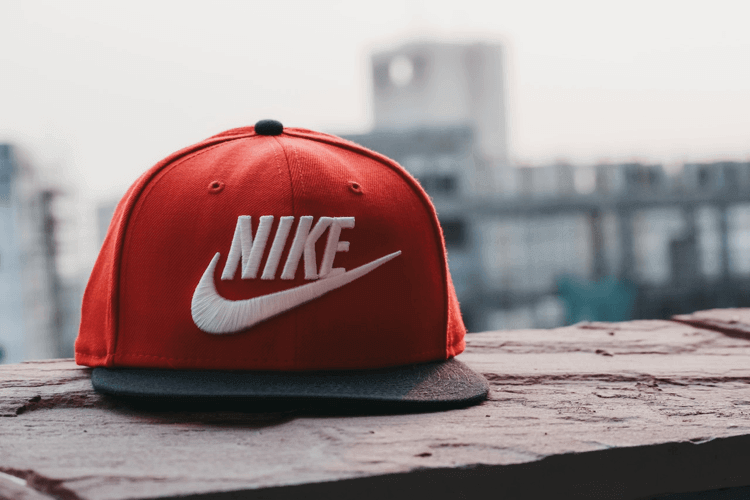 Red nike hat with white logo