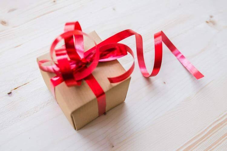 a present wrapped with red ribbon