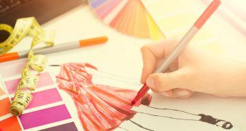 fashion designer working in studio. close up design.