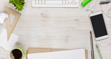 wooden work desk top view with copyspace in the middle
