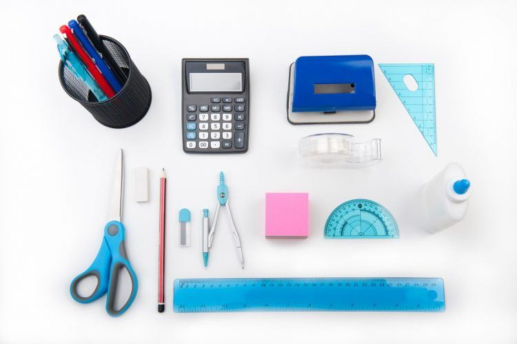 calculator and other office supplies on a white table