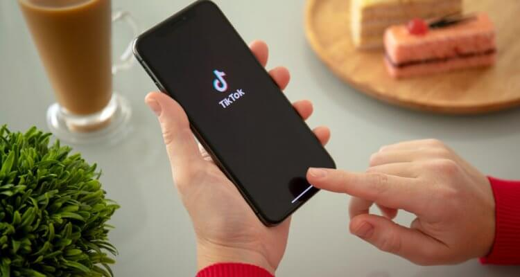 A photo of an iPhone with TikTok logo on it